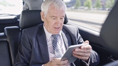 Businessman in Car Late for Meeting Stock Footage