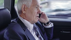 Businessman in Car Calling Partners Stock Footage