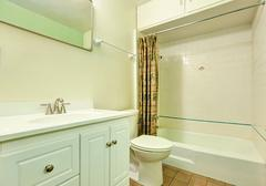 White clean bathroom interior with vanity cabinet,  Stock Photos