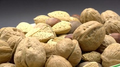 Mixed Nuts Walnuts Filberts Almonds Brazil Nuts Pecans Rotating, 4K Stock Footage