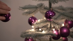 Men hands hanging toy on christmas tree Stock Footage