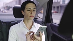 Woman Calling Friend in Car Stock Footage