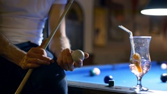 Man sitting on billiard's table and playing with ball Stock Footage