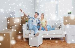 Couple with boxes moving to new home and dreaming Stock Photos