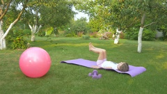 The girl doing the exercise in the garden Stock Footage