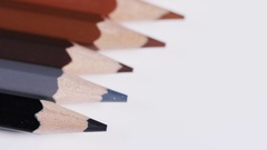 4K Blurred tilt up across multiple coloured pencils Stock Footage