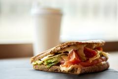Salmon panini sandwich on stone plate at cafe Stock Photos