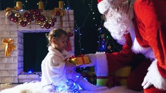 Santa gives a gift box to cute little girl, Christmas Stock Footage