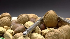 Nutcracker Crushing Walnut in Shell Rotating Isolated on Black, 4K Stock Footage