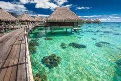 Over water villas on a tropical lagoon of Moorea Island, Tahiti Stock Photos
