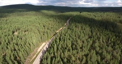 Drone flight over a road in a finland forest Stock Footage