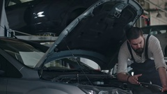 Maintenance Worker Checking Car Stock Footage