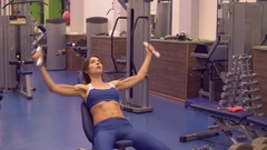 Caucasian girl trains with dumbbells Stock Footage