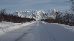 Driving on a winter road in Lofoten, Norway Stock Footage