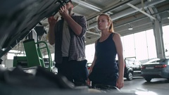 Working Together at Repair Garage Stock Footage