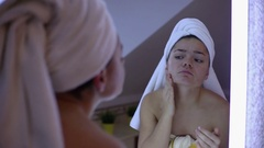 Woman is squeeze pimple in bathroom Stock Footage
