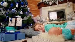 Little cute girl hugging a doll during sleep, The child sleeps near a Christmas Stock Footage