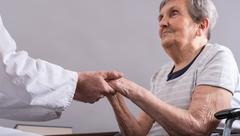 Assistance to elderly Stock Photos