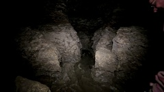 Men Walks in the Cave. Speleolog in the Cave Stock Footage