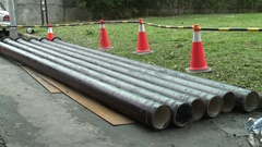 Water pipes laid on the asphalt of a road Taipei, Taiwan. Stock Footage