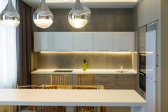 Modern kitchen interior in new luxury home, apartment Stock Photos