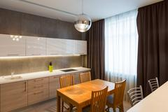 Modern kitchen interior in new luxury home, apartment Kuvituskuvat