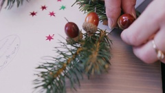 Christmas card and a fir branch on a table. Xmas Decorations Stock Footage