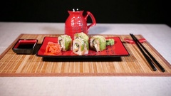 Japanese Green Sushi On Plate With Chopsticks On Bamboo Background Stock Footage