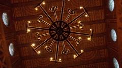 4k Wooden Stave Church interior chandelier overhead shot Hahnenklee Harz Stock Footage