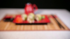 Japanese Green Sushi On Red Plate Stock Footage