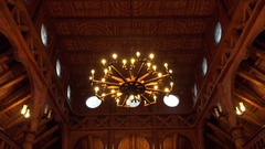 4k Wooden Stave Church indoor entry tilt down Hahnenklee Harz mountain range Stock Footage