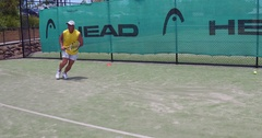 Tennis backhand and slide Stock Footage