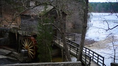 Historic mill barn on stone mountain lake Stock Footage