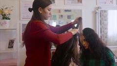 Hairstylist and make-up artist working at model image. Stock Footage