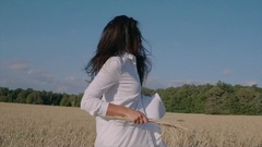 Young woman in beautiful dress on a wheat field Stock Footage