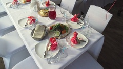 Catering service. Restaurant table with food. Plates of food. Dinner time, lunch Stock Footage