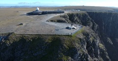 Flying around the North Cape globe monument Stock Footage