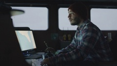 Captain Surrounded by Monitors and Screens with Sea Maps. Stock Footage