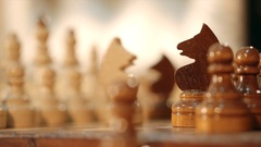 Playing wooden chess pieces Stock Footage