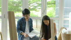 4K : Asian lovely girl helping her father assembling new DIY furniture Stock Footage