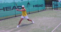 Tennis wide forehand hit and slide Stock Footage