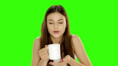 Chromakey footage Young sick girl is drinking medicine. Indoor photo. Close up Stock Footage