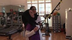 Physiotherapist assisting patient while doing exercise. Stock Footage
