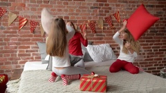 Triplets sisters in pajamas have arranged fight by pillows. The bedroom is Stock Footage