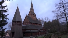 4k Wooden Stave Church outdoor panning Hahnenklee Harz village hill Stock Footage
