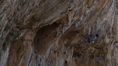 Female climber working hard on a extremely overhanging steep Stock Footage