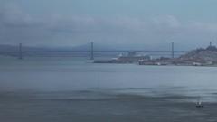 Sailboat heading towards Bay Bridge San Fransisco tight Stock Footage