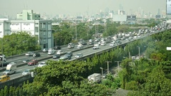 Thai people drive cars and trucks with traffic road on expressway Stock Footage
