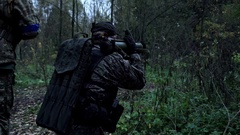 Military in the forest shoots from a grenade launcher Stock Footage