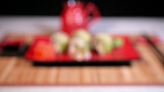 Green Sushi On Plate With Chopsticks And Souce Stock Footage